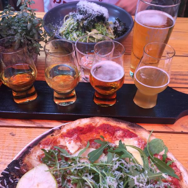 Beer tasting tray and delicious food at Hallertau
